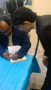 """Moja team and holding a signing ceremony for the novel """"Frankenstein in Baghdad"""" by the Iraqi novelist Ahmed Saadawi"""